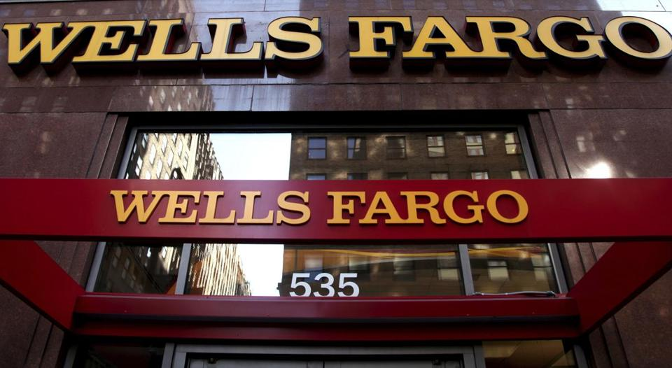 FILE - In this May 6, 2012, file photo, a Wells Fargo sign is displayed at a branch in New York. The nation's big bank regulator is faulting itself for failing to address the problems at Wells Fargo before it was too late. The inspector general at the Office of the Comptroller of the Currency said Wednesday, April 19, 2017, the Comptroller's examiners saw sales problems at Wells Fargo as early as 2010. (AP Photo/CX Matiash, File)